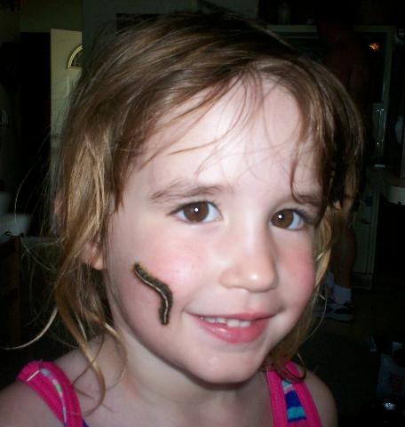 "Alexandria ""Alex"" with her pet caterpillar!"