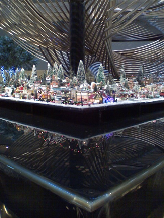 A tiny portion of the huge Christmas Village surrounded by a waterfall