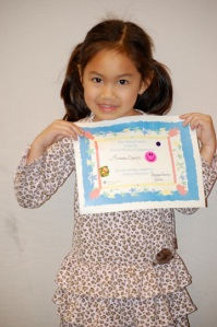 Miranda holds her certificate with pride.