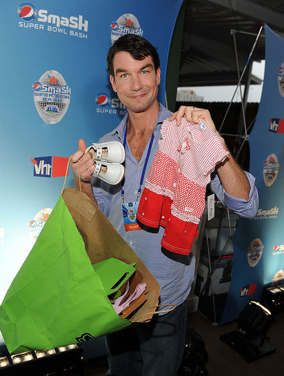 Jerry O'Connell holding Smarty Pants Gift and our le•top Daisy Dot dress, as seen in popsugar.com