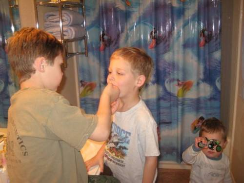 Big brother Nate pulling on Jake's loose tooth. Zach: Ah! I can't watch!!