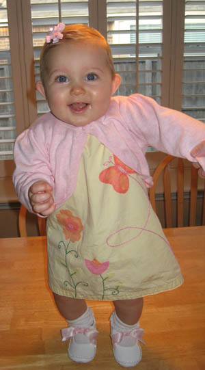 Happy Baby! 9 month old Anna is standing...sort of!