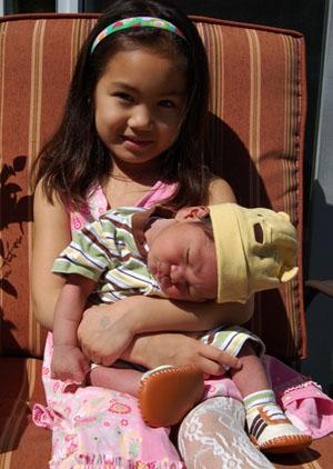 Miranda holding Paulo (and needing a few tips on holding up baby's head!)