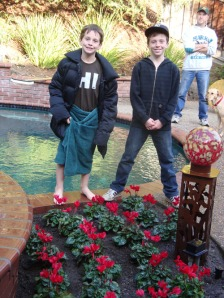 Nicholas and Dylan (in towel) after the planting and a little swim