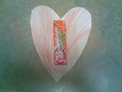 A hand-colored heart, to which the first pack of gum was taped...