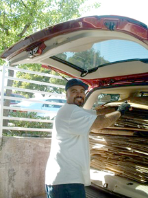 Tony (our warehouse crew worker) loading the le•top boxes into the community garden van